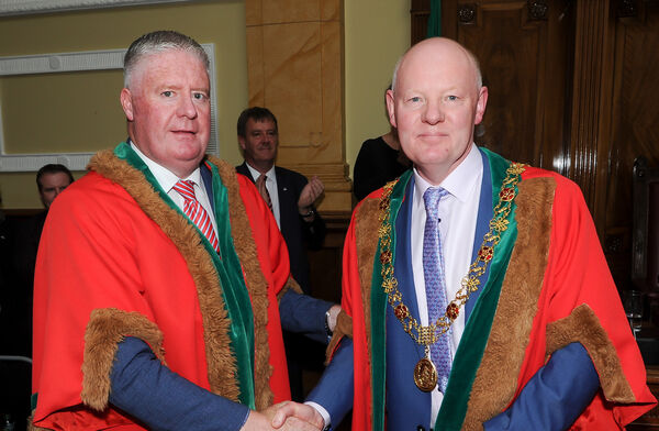 Newly elected Lord Mayor of Cork Cllr John Sheehan, is congratulated by the outgoing Lord Mayor Cllr Mick Finn at City Hall, Cork. Picture: David Keane.