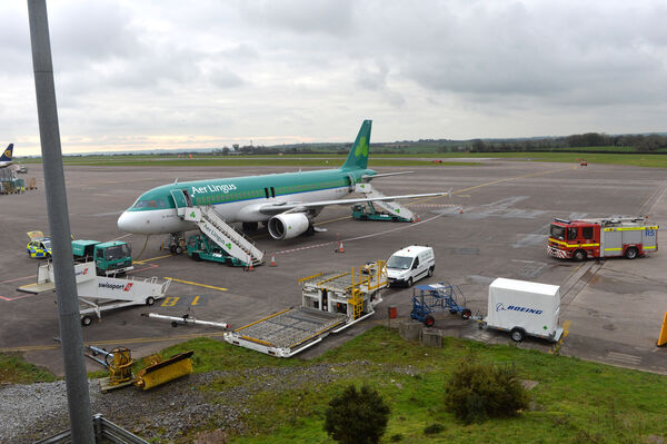 The emergency overwing doors opened and the slide down on the Aer Lingus plane which was directed back to Cork Airport after reports of smoke in the cockpit. Picture Dan Linehan