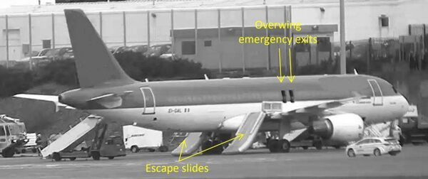 Image from the Air Accident Investigation Unit report showing the plane at Cork Airport with the escape chutes deployed.