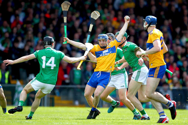 Clare's Podge Collins is swarmed by the Limerick defence. Picture: INPHO/James Crombie