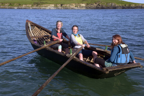 Pictured at Sandycove Co Cork with their Curragh was Katie MacShane with Sinead and Elaine Moynihan. Picture Denis Boyle