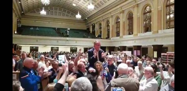 Des Cahill celebrating with party supporters.