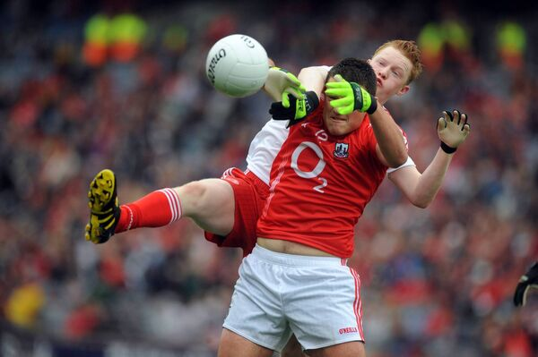 Dan MacEoin tussles with Tyrone's Hugh Pat McGeary in 2010. Picture: Eddie O'Hare