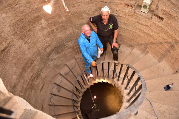 Volunteers Francis O'Brien and Paschal Cullen on the spiral staircase. Picture Dan Linhan
