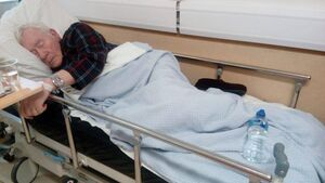 Family of man left on hospital trolley demand change