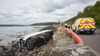Man arrested after lorry crashes into sea