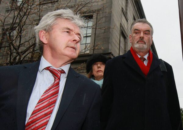 Solicitor Frank Buttimer watched by Jules Thomas and Ian Bailey outside the Four Courts in 2015. Pic: Courts Collins
