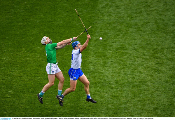 Michael Walsh of Waterford in action against Cian Lynch of Limerick. Picture: Ramsey Cardy/Sportsfile
