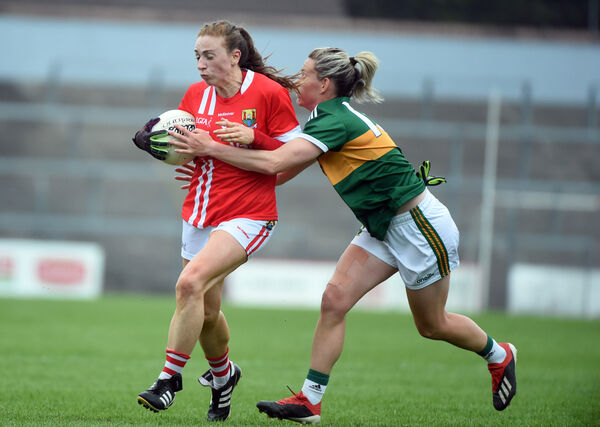 Aishling Hutchings runs is tackled by Amy Foley, Kerry. Picture: Larry Cummins.