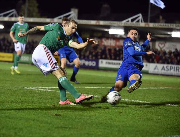 Karl Sheppard shoots from Waterford's Shane Duggan. Picture: Eddie O'Hare