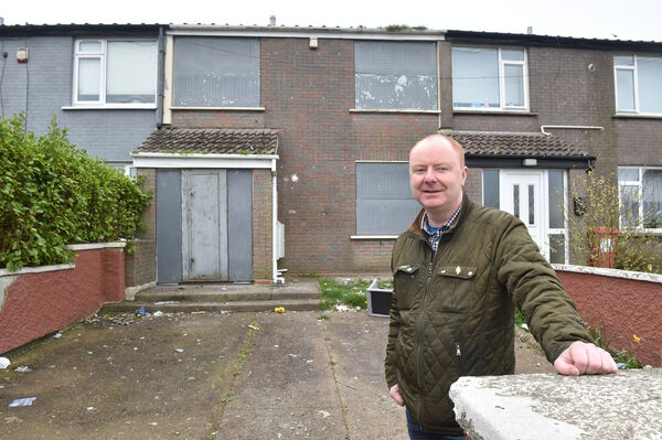 Cllr. Mick Nugent standing in front of one of the derelict houses at Liffey Park,, Mayfield. Picture Dan Linehan