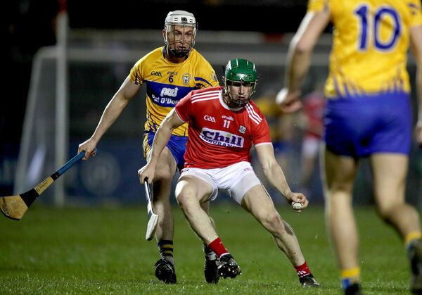 Clare's Conor Cleary and Seamus Harnedy of Cork. Picture: INPHO/Bryan Keane
