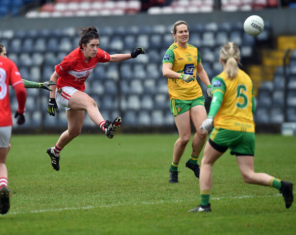 Ciara O'Sullivan shoots from Donegal's Karen Guthrie. 	 Picture: Eddie O'Hare