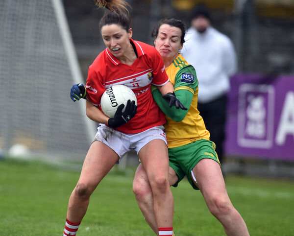 Eimear Scally is tackled by Donegal's Nicole McLaughlin.	 Picture: Eddie O'Hare