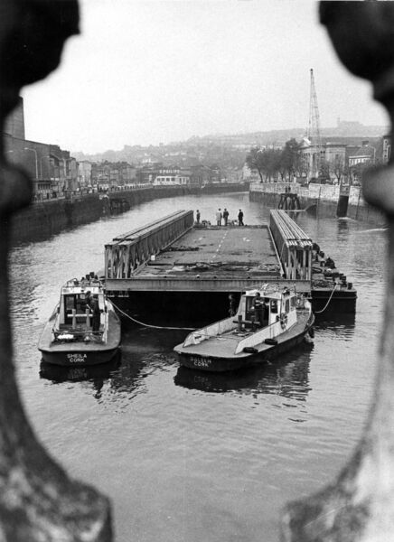 The bailey bridge heading upstream to its new berth near the Opera House after it had passed under Patrick's Bridge with inches to spare. It was in operation while Christy Ring Bridge was under construction