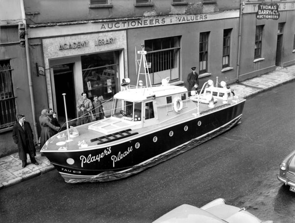 The 'Players Please' float promoting the cigarette brand appeared in the St Patrick's Day parade in 1956. Here it is pictured at Academy Street.