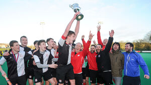Harlequins came from three down to lift the cup after a battle with Bandon