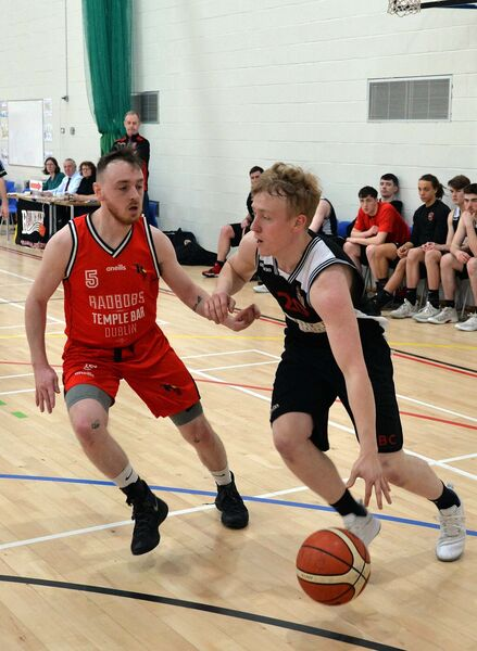 Alex Chandler of Tradehouse Central Ballincollig trying to get past Paul Caffrey. Picture Denis Minihane.