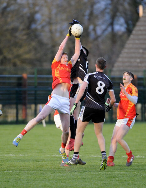 Eoin Stanton wins the ball midair against Kiskeam. Picture: Gavin Browne