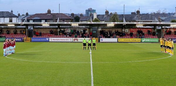 The two teams and Anthony Buttimer, Trevor Cotter and Ricky Crean, during the minute silence for the late Pat McAuliffe. Picture: Jim Coughlan.