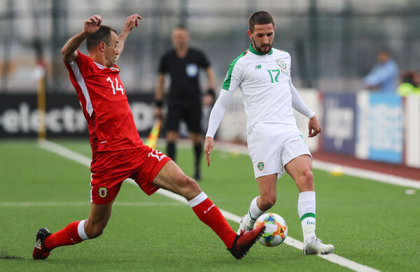 Gibraltar's Roy Chipolina with Conor Hourihane. Picture: INPHO/Ryan Byrne