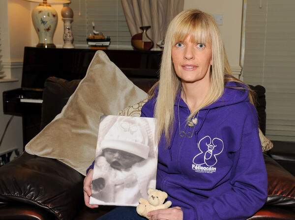 Carmel O'Shea at her home in Cobh, holding a picture of her late daughter Maddie-Lou. Picture: David Keane.