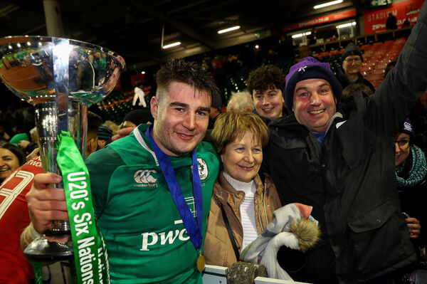 Ireland's John Hodnett celebrates with his family after the Grand Slam win. Picture: INPHO/Ryan Byrne