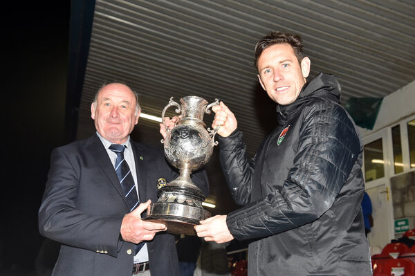 Cork City captain Alan Bennett receives the trophy from Richard Browne. Picture: Eddie O'Hare