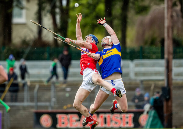 Cork's Cormac Murphy with Michael Breen of Tipperary. Picture: INPHO/Morgan Treacy