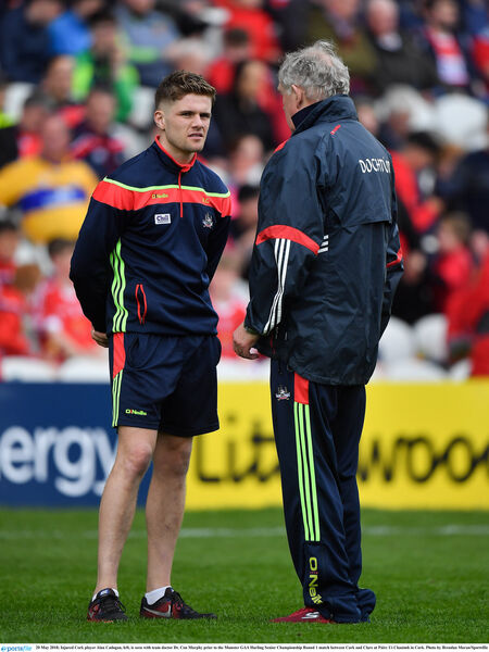 Alan Cadogan chatting with Dr Con Murphy. Picture: Brendan Moran/Sportsfile