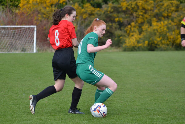 Nadine Seward of Cork holds off the challenge from Rhianna Mason. Picture: Howard Crowdy
