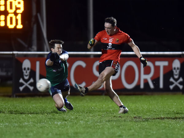 UCC's Paudie Clifford blasts the ball past Athlone IT's Einne O'Connor. Picture: Eddie O'Hare