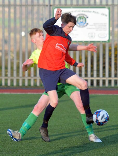 Springfield Ramblers A's Ciarán Griffen wins the ball against Greenwood's Adam Cronin. Picture: Denis Minihane.