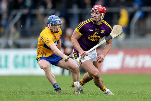 Wexford's Lee Chin and Cathal Malone of Clare. Picture: INPHO/Laszlo Geczo