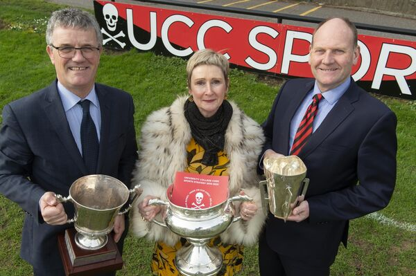 Professor John O'Halloran, Dr Fiona Chambers and Morgan Buckley, Director of Sport in UCC, with the cups. Picture: Provision