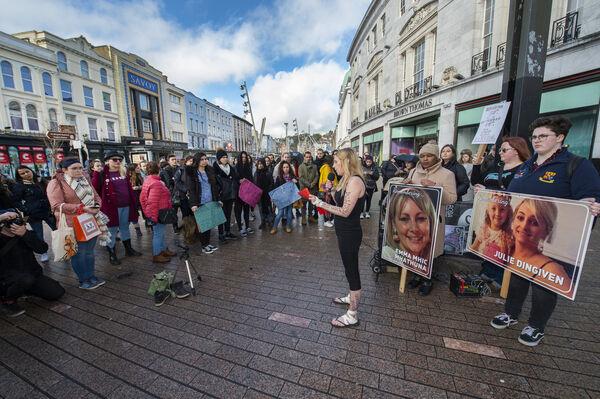 Áilbhe Hines reading a poem at the Time4Equality rally for International Women's Day on Patrick Street, Cork. Picture Dan Linehan