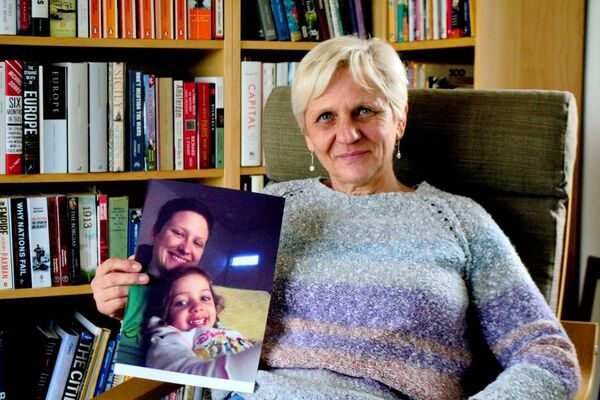 Erika Sexton holding a photo of her daughter Tina and granddaughter Zoey at her home in Ballinacarriga photo Shamim Malekmian