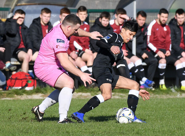 Cobh Ramblers' Denzil Fernandes keeps possession as Wexford's Sean Kelly closes in. Picture: David Keane.
