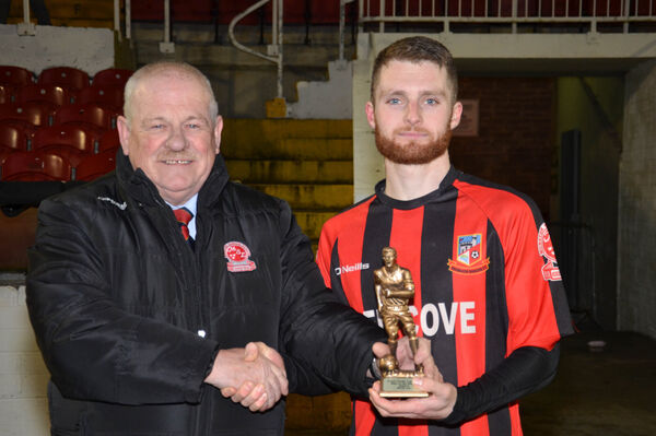 Leslie Doyle presents the Man of the Match award to Anthony McAlavey. Picture: Howard Crowdy