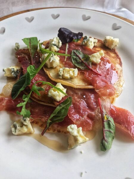 Buttermilk Pancakes with Serrano ham, blue cheese and maple syrup. Picture: Di Curtin