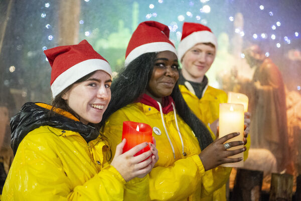 Aoife O'Herlihy and Ife Salami from Ballyphehane and Niall Lyons from Ballinhassig at the blessing of the SHARE crib on Daunt Square. Picture: Gerard McCarthy