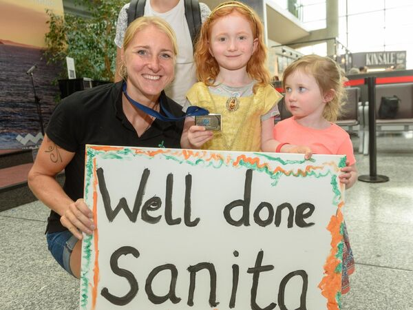 Sanita Puspure in Cork Airport on her return from Lucerne where she took the silver medal in the single sculls A final at the World Rowing Cup with young fans Laoise and îrla N' Chonchœir from Bandon.Pic. John Allen/Provision