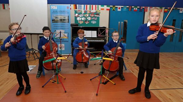 Getting ready to play for the guests are Young Musicians, Mia Sokl, Oisin Kiely, Shay O'Leary, Thomas Reilly and Pearla Sentyte, pictured at the official opening of the new Scoil Aonghusa school building, Castle Park Village, Mallow, Co. Cork.