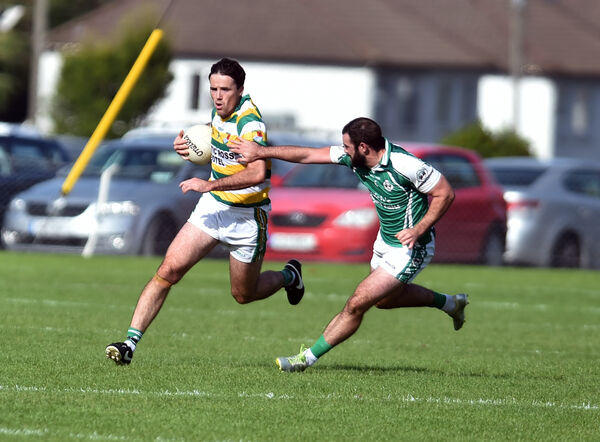 Carbery Rangers' James Fitzpatrick bursts past Ballincollig's Noel Galvin. Picture: Eddie O'Hare