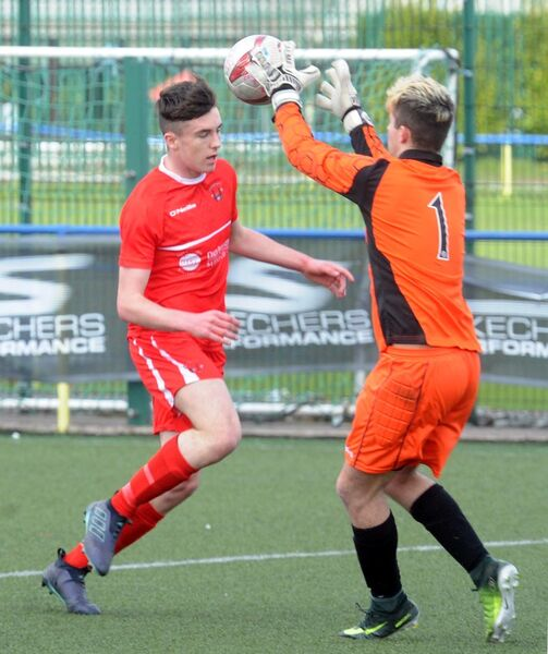 Galway League goalkeeper Kallum Fahy saves from Cork Youth Leagues' Ethon Varian. Picture: Denis Minihane.