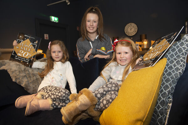 Amelia Brown, Belle and madison McGillicuddy, Carrigaline, Cork find a resting place at the big Winter sale at EZ living interiors at the Southside Industrial Estate. Picture Dan Linehan