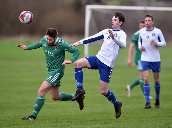 Cork City's Aaron Barry heads clear from Limerick's Karl O'Sullivan. Picture: Eddie O'Hare