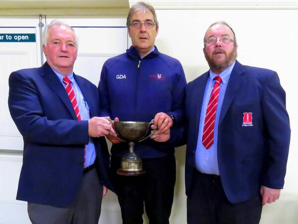 Imokilly board members Donal O'Keeffe and Michael O'Brien presenting East Cork GDA Shane Supple with the James Colbert Memorial Cup.