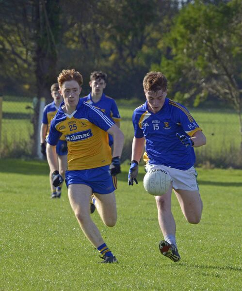 Cormac Buckley, De La Salle Macroom, tackling Fionn Herlihy for Hamilton High School. Picture: Denis Boyle