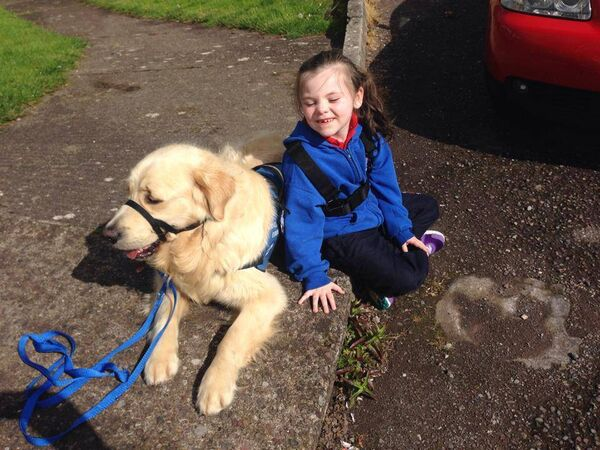 Amy with her previous assistance dog Charlie who died of cancer.